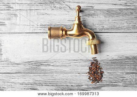 Water shortage concept. Tap with rust on wooden background