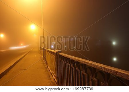scary steet in the fog at night