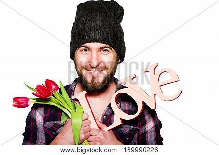 young hipster man in black hat with white tulips and nameplate LOVE