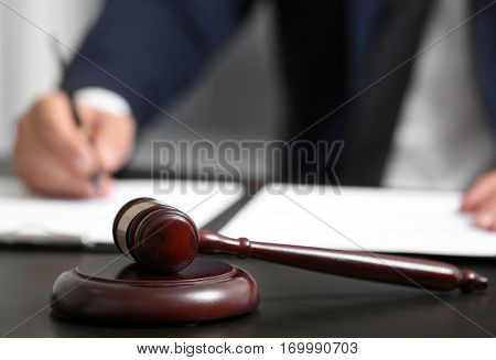 Judge gavel on table, closeup