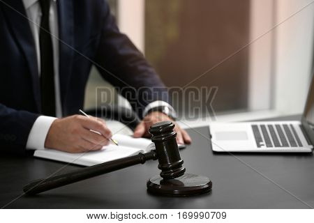 Judge gavel on table, closeup