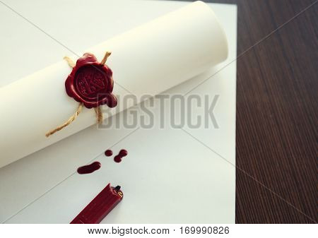 Old notarial wax seal on tied scroll