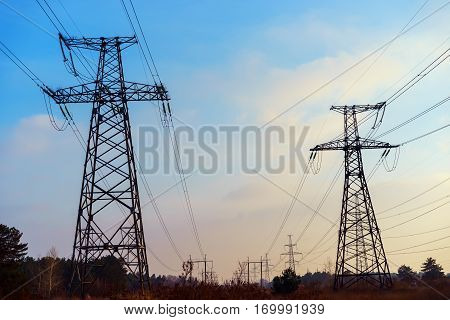Electricity pylons and cable lines. vertical format