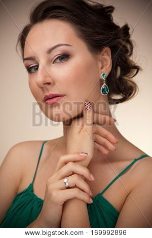 Portrait Of Beautiful Woman With Make Up And Hairstyle At Studio