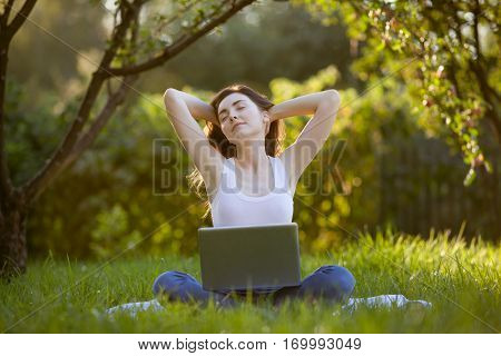 Picture Of Beautiful Woman Relaxing With Laptop At Park