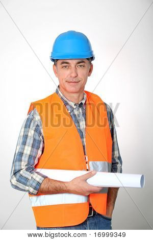 Entrepreneur standing with plan on white background