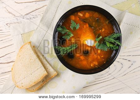delicious saltwort soup in a black bowl and bread
