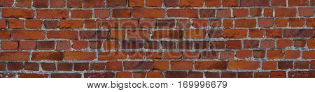 panorama brick wall orange masonry uneven wide and narrow stone