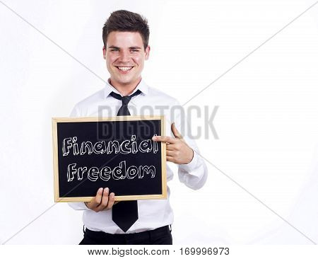 Financial Freedom - Young Smiling Businessman Holding Chalkboard With Text