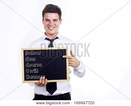 Follow One Course Until Success Focus - Young Smiling Businessman Holding Chalkboard With Text