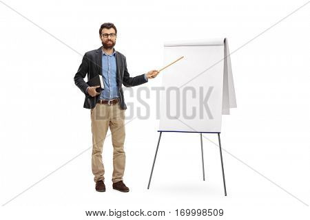 Full length portrait of a teacher holding a book and pointing with a wand at a blank presentation board isolated on white background