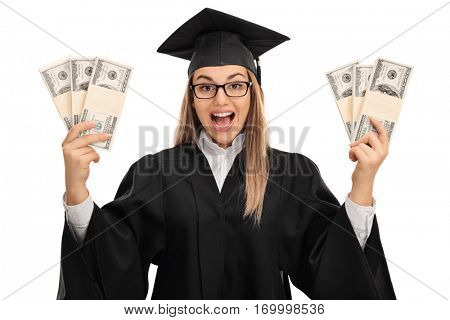 Overjoyed graduate student holding bundles of money isolated on white background
