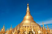 Biggest golden stupa in Shwedagon Zedi Daw (Great Dagon Pagoda, Golden Pagoda), Yangon, Myanmar (Burma). On blue sky background poster