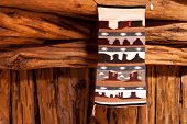 Traditional handmade wool Navajo rug with Monument Valley elements poster