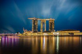 SINGAPORE - DECEMBER 10 2016: The Helix Bridge Marina bay sands & Artscience museum at night. Marina Bay Sand iconic design has transformed Singapore's skyline. Designed by architect Moshe Safdie.