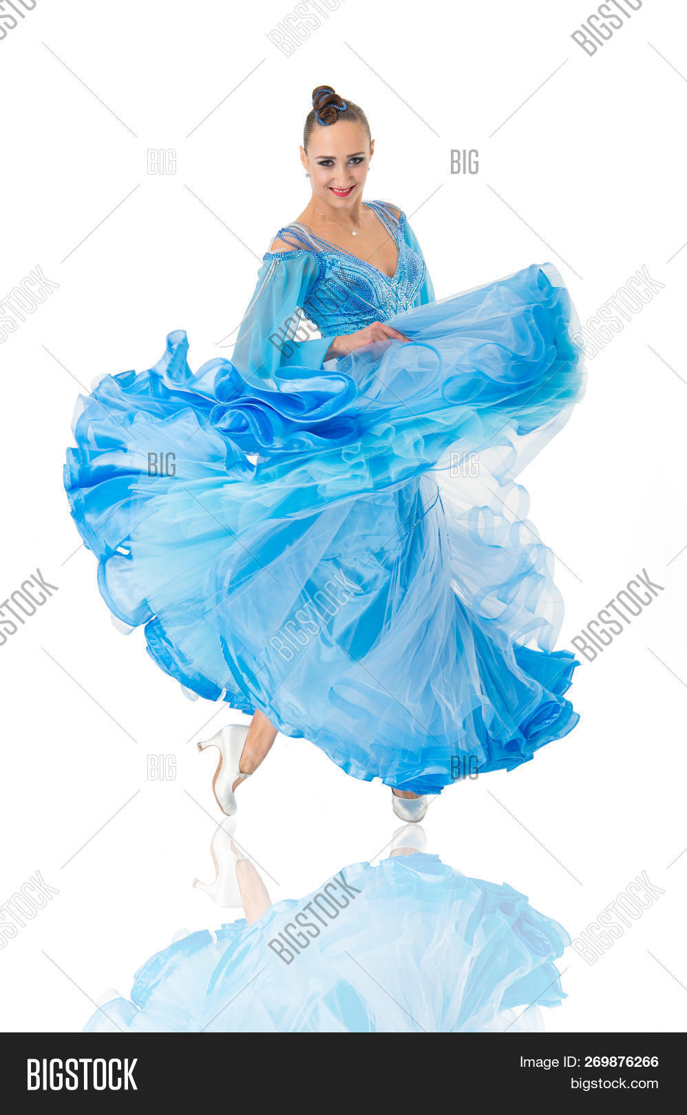Wonderful Girl On Smiling Face Dressed In Luxury Blue Dress Posing With Posture.  Dancer Of Ballroom