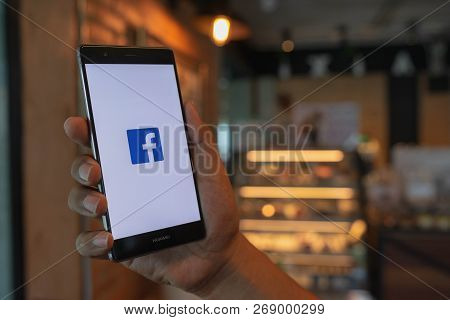 Chiang Mai, Thailand - June 09,2018: Man Holding Huawei With Facebook App On The Screen. Facebook Is