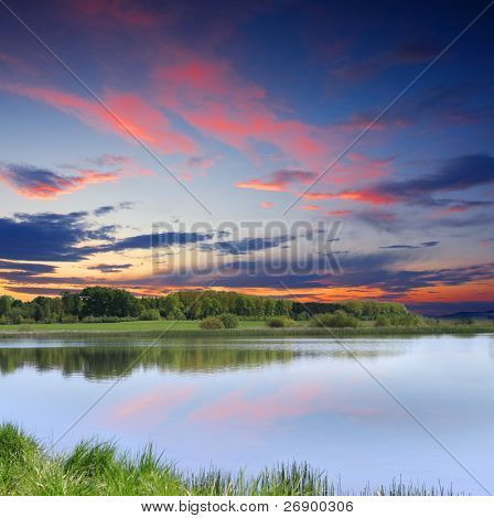 Beautiful morning landscape with the lake