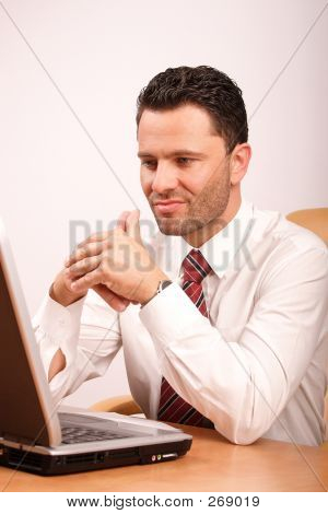Busy Thinking Man With Laptop