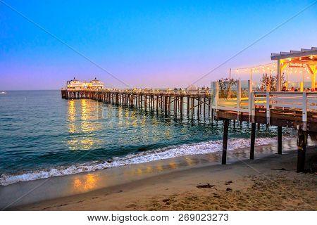Scenic Coastal Landscape Illuminated By Night Of Malibu Pier In Malibu, California, United States Se