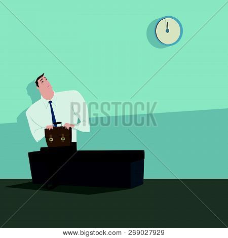 Young Man Sitting On The Chair Looking The Clock Waiting For Someone.