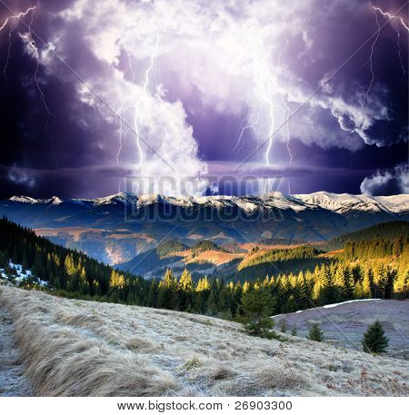 Thunderstorm with lightning in mountain landscape