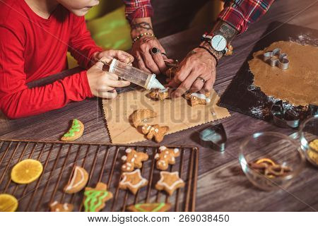 Father And Son Baking Gingerbread Christmas Cookies