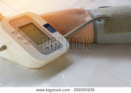 People Are Check Blood Pressure Monitor And Heart Rate Monitor With Digital Pressure. Healthcare And
