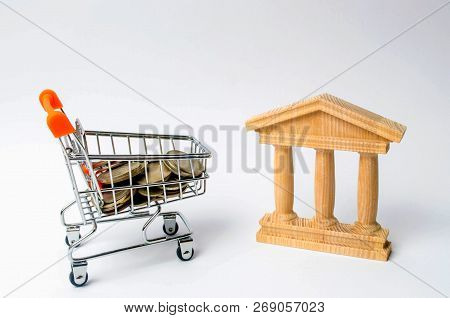Bank And The Trolley With Money. The Concept Of Dividend Payments, Deposits In Banks. Banking System