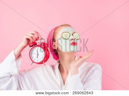 Young Woman With Cosmetic Mask On Face With Cucumber Slices To Eyes. Beautiful Woman With Facial Mas