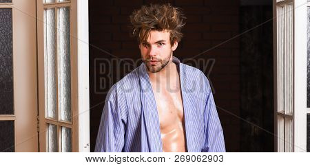 Sexy Bachelor Lover Concept. Sexy Attractive Macho Tousled Hair Coming Out Through Bedroom Door. Guy