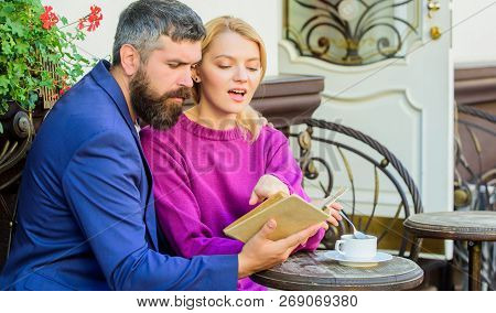 Common Interests. Man With Beard And Blonde Woman On Romantic Date. Couple In Love Sit Cafe Terrace.