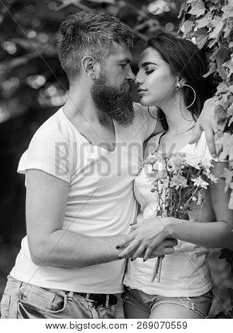 Man Bearded Hipster Hugs Gorgeous Girlfriend. Couple Love Romantic Date Nature Park Background. Love