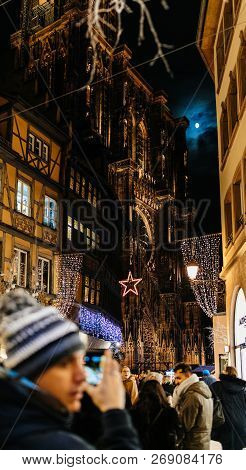 Strasbourg, France - Nov 29, 2017: Adult Male Couple Taking Photo On Smartphone Of Notre-dame Cathed