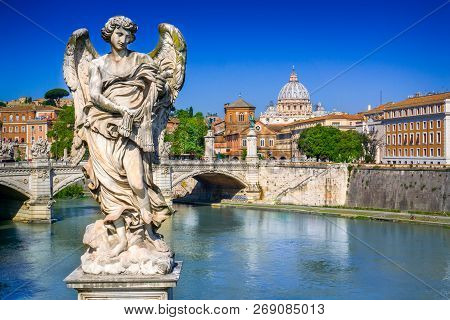 View From Ponte Sant Angelo On Tiber In Rome, Italy. On The Background The St. Peter Basilica In Vat