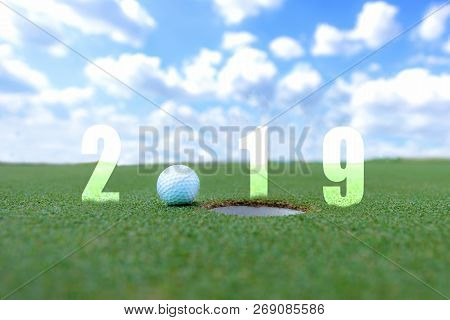 Golf Sport Conceptual Image.happy New Year 2019. Golf Ball On The Green Fairway, Blue Sky Background