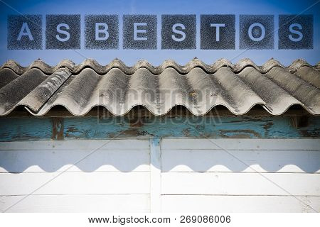 Dangerous Asbestos Roof.  The Word Asbestos Written With Letters Whose Graphic Resembles The Shape O