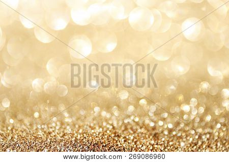 Golden Sparkle Glitters With Bokeh Effect And Selectieve Focus. Festive Background With Bright Gold