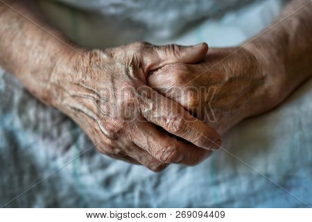 Elderly Woman With Folded Hands. Hands Of An Old Woman Close Up. Hands Of An Old Woman Folded One Ov