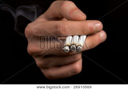 smoker holding three cigarettes