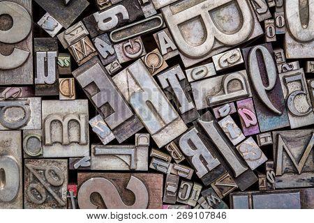 background of random vintage letterpress metal type printing blocks