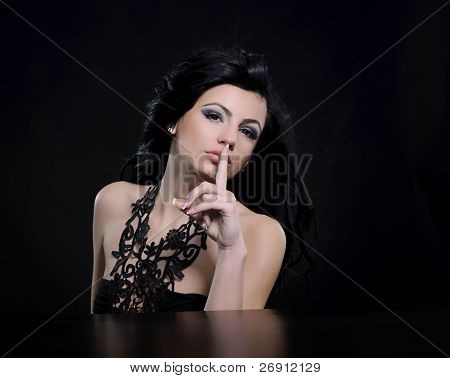 silence; woman putting finger on lips