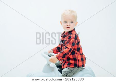 Fun But Safe. Little Baby Enjoy Playing In Kindergarten. Little Child Ride On Toy Car. Boy Child On