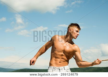 His Sporty Ambition. Sport Man Develop Muscular Hand Strength. Strong Man Pull Rope. Athlete With Fi
