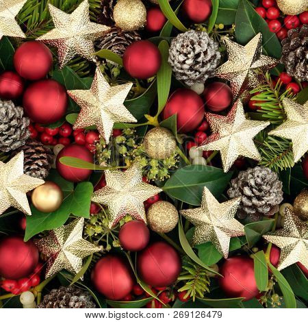 Christmas background star and ball bauble decorations with holly, ivy, mistletoe and pine cones. Festive holiday season Christmas greeting card.