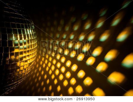 Disco ball with reflection on the wall