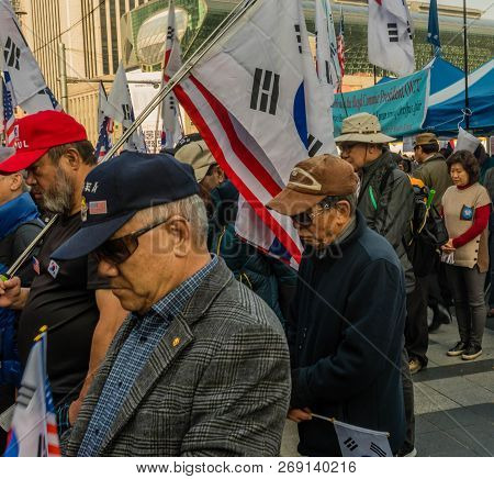 Seoul, South Korea; November 10, 2018: Unidentified Crowd Of Koreans Bow In Prayer At Rally Against