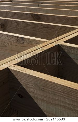 The Floor Joist Stringers Of A New House Construction Form A Geometric Abstract