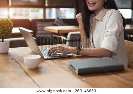 Beauty Asian Woman Having Cheerful Gesture After Finishing Job Happily With Laptop Computer In Cafe.
