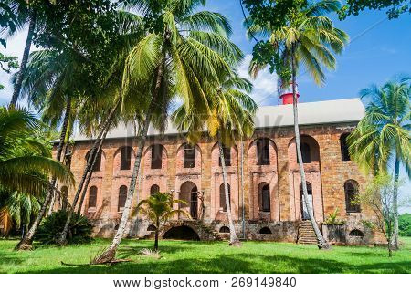 Former penal colony at Ile Royale, one of the islands of Iles du Salut Islands of Salvation in French Guiana poster